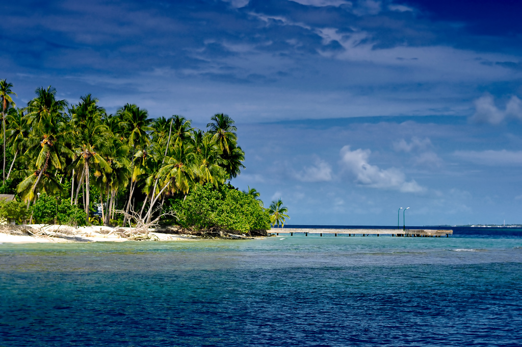 Rising sea levels threaten the livelihoods of 55 million people living on India's coasts. Kuda Bandos, Maldives. Credit: nattu/Flickr, CC BY 2.0