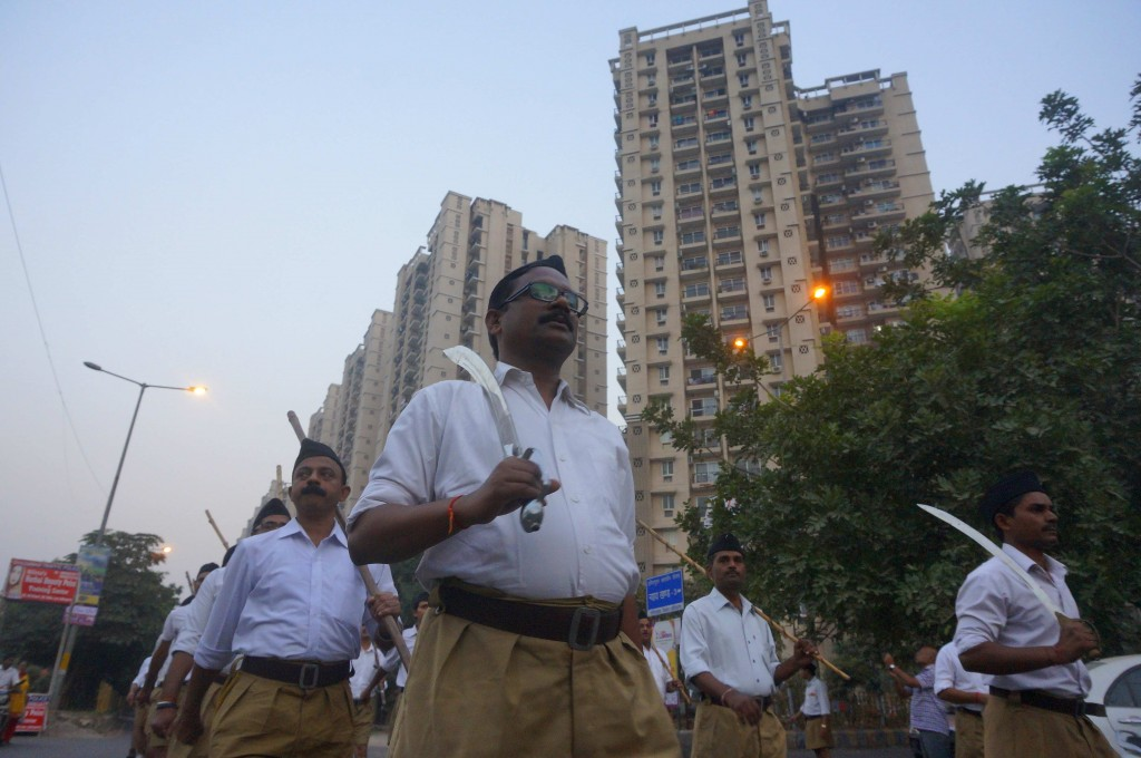 Brandishing swords, swayamsevaks march on an Indirapuram street. Credit: Shoma Basu