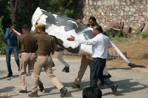 The Jaipur police cart away Siddhartha Karawal's 'Bovine Divine' on Saturday: Credit: The artist
