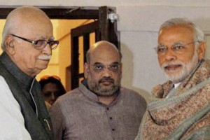 Prime Minister Narendra Modi greets senior BJP leader L.K. Advani on his 88th birthday in New Delhi on Sunday. BJP President Amit Shah is also seen. Credit: PTI