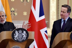 Prime Minister Narendra Modi speaks as his UK counterpart David Cameron looks on during a joint press conference in London on Thursday. Credit: PTI Photo by Vijay Verma