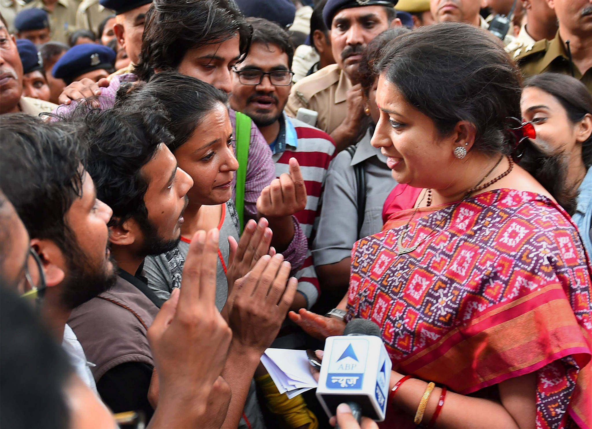 Smriti Irani meets students protesting the UGC's decision. Credit: PTI