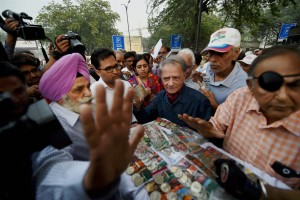 Ex-servicemen returning their medals during their agitation for the One Rank One Pension (OROP) scheme near the IGI airport in New Delhi on Tuesday.  Credit: PTI Photo by Subhav Shukla