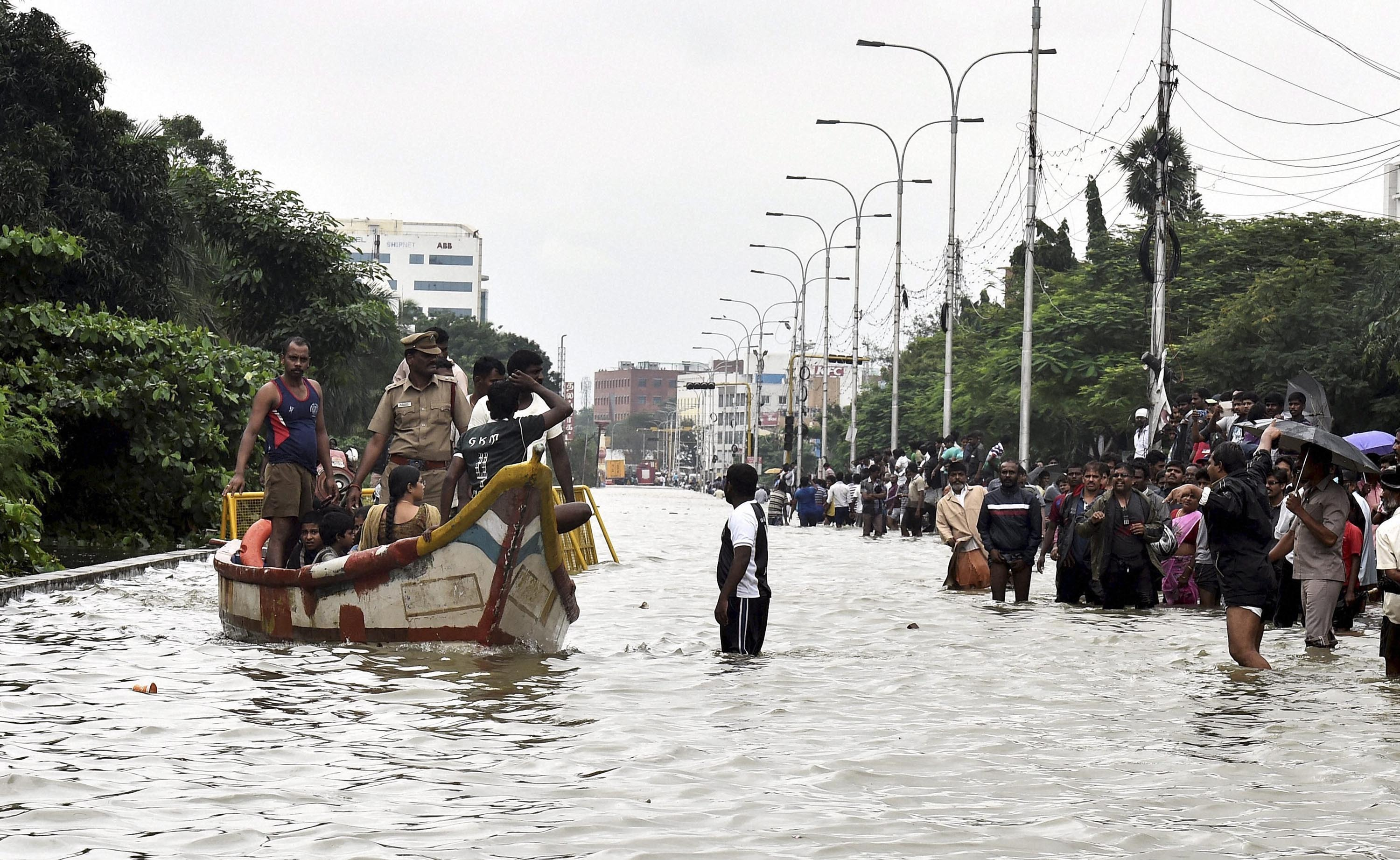 People rescue from their water-lodged houses during heavy rains in Chennai on Wednesday. Credit: PTI
