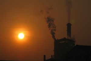 Picture of a smoggy sunrise shot in an unknown location in India. Credit: spykster/Flickr, CC BY 2.0