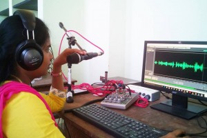 A volunteer at the Cuddalore Emergency community radio broadcasts a notification from the district administration regarding ongoing relief work . credit: Peridar Kaala Vaanoli emergency CR station
