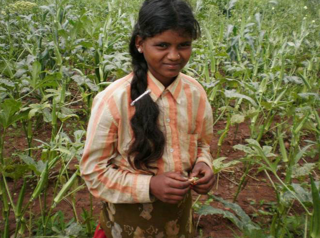 A young girl working in a seed farm. Credit: Soiled Seeds