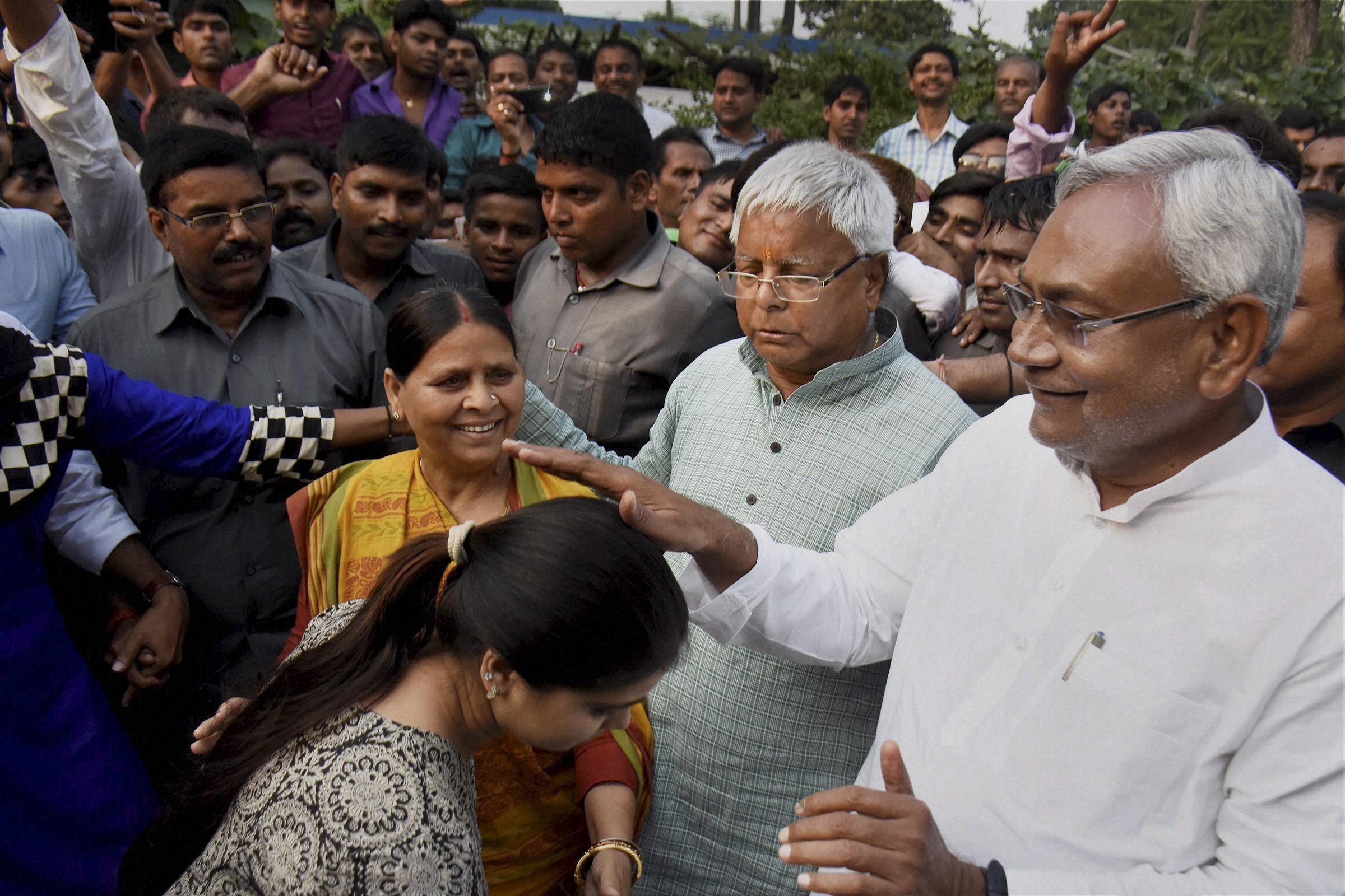 Bihar chief minister Nitish Kumar blesses a daughter of RJD chief Lalu Prasad and Rabri Devi after the Mahagathbandhan's (Grand Alliance) victory in the Bihar assembly elections in Patna. Credit: PTI