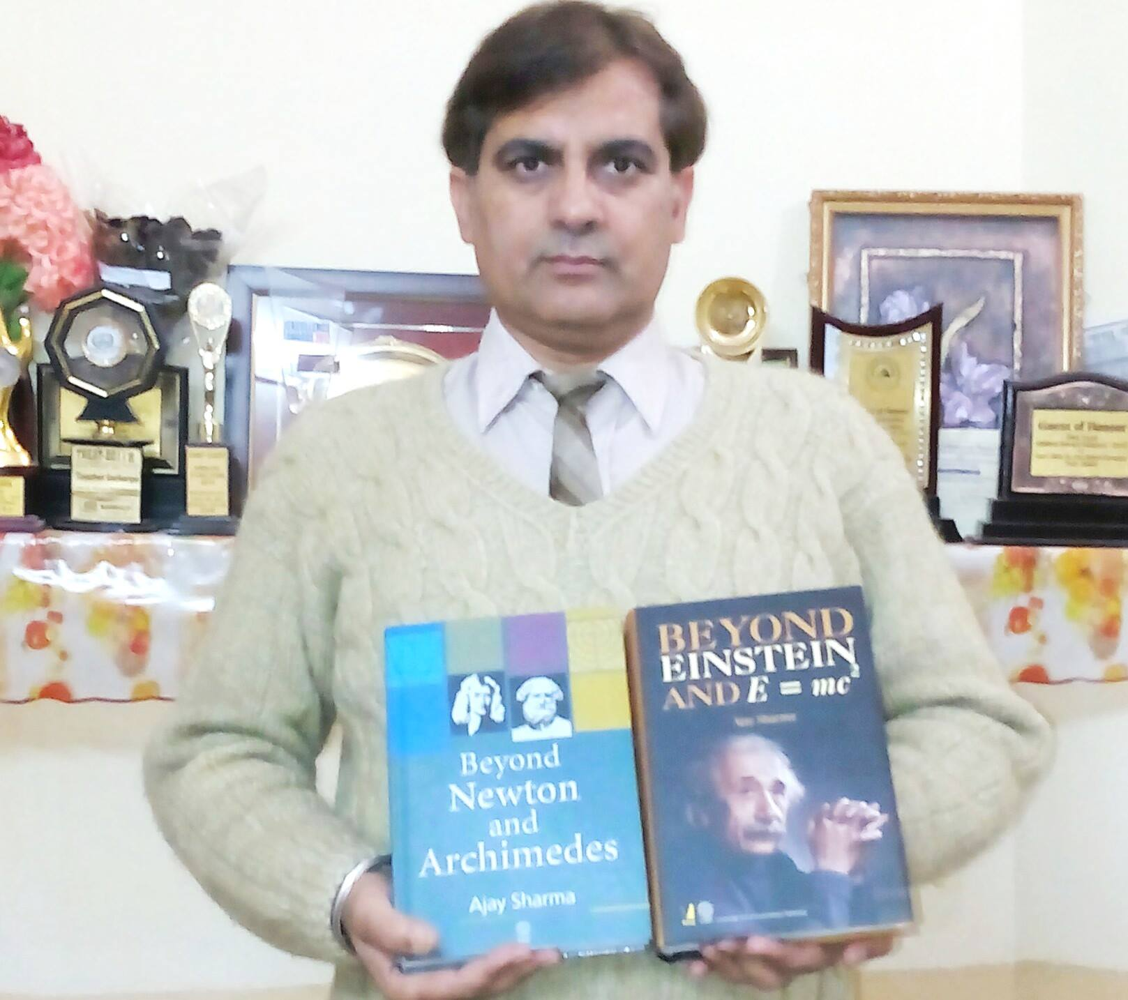 Ajay Sharma with two of his books. Source: Fundamental Physics Society (Facebook page)