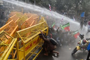 Police use water cannons to disperse students during a protest against the Ministry of Human Resource Development in New Delhi on Monday over the suicide of a PhD scholar Rohith Vemula at University of Hyderabad. Credit: PTI Photo by Atul Yadav