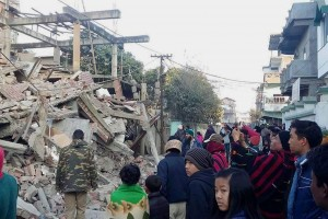Imphal: People gather near a collapsed building after a massive earthquake in Imphal on Monday morning. PTI Photo (PTI1_4_2016_000179A) *** Local Caption ***
