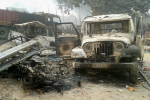 Vehicles set on fire after clashes between two groups at Kaliachak police station in Malda on Sunday. Credit: PTI