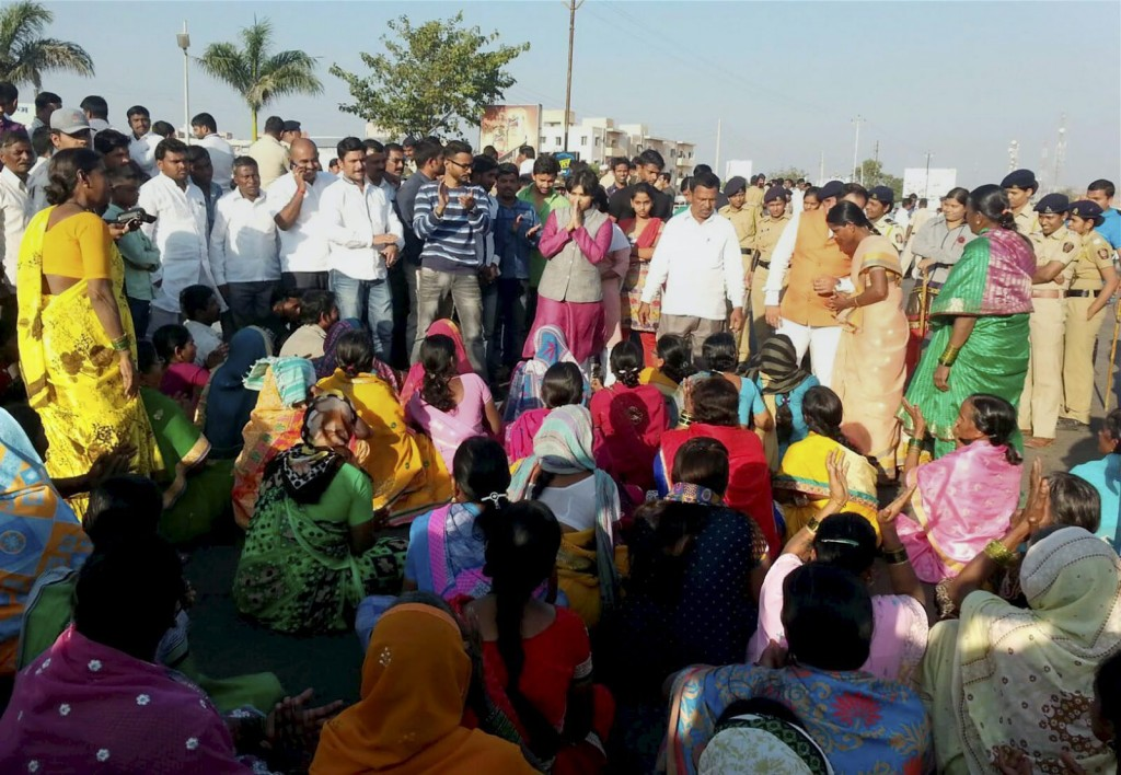 A group of women devotees, led by Trupti Desai (in pink), who headed the protest by women activists for entry to the Shani Shignapur temple complex, participate in a dharna at the temple in Ahmadnagar district on Tuesday. Credit: PTI