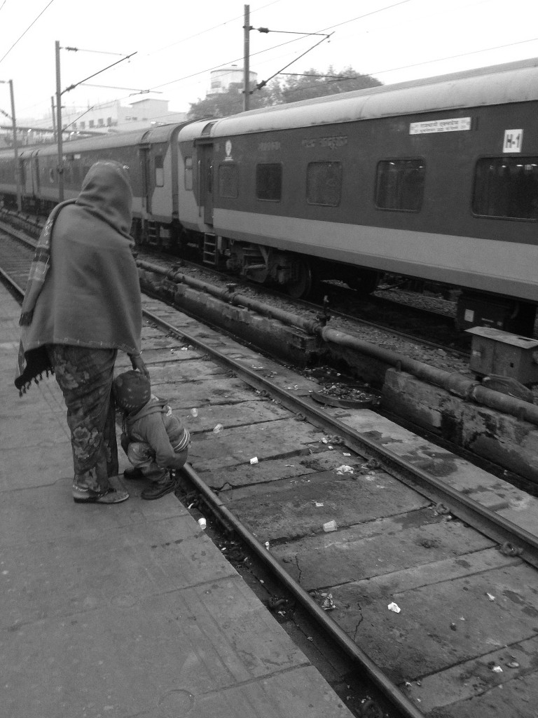 You gotta go when you gotta go: A lack of usable bathrooms forces this child to relieve himself on the tracks of New Delhi's railway station. Credit: Shome Basu