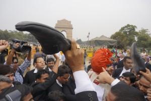 Lawyers beat an effigy of Kanhaiya Kumar with shoes on Rajpath in the capital. Credit: Shome Basu