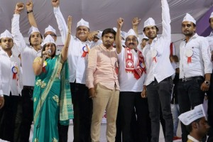 Leaders from Patel or Patidar community raise their hands attending a reservation rally led by Bardik Patel (center) at Bapunagar in Ahmedabad on February 27, 2016. Credit: PTI