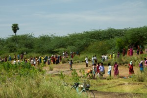 NREGA in Action: Villagers dig out a silted-up water tank. Credit: McKay Savage