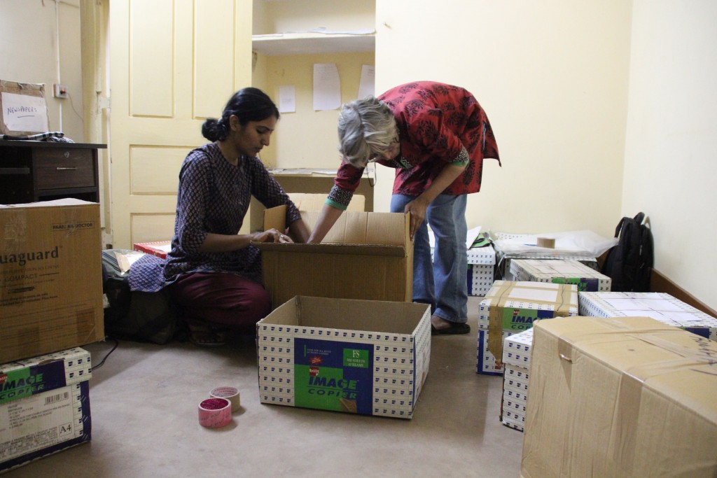 Isha Khandelwal and Shalini Gera of JagLAG packing their office and home in Jagdalpur on February 20 following intense pressure to leave Bastar. Credit: Mukta Joshi