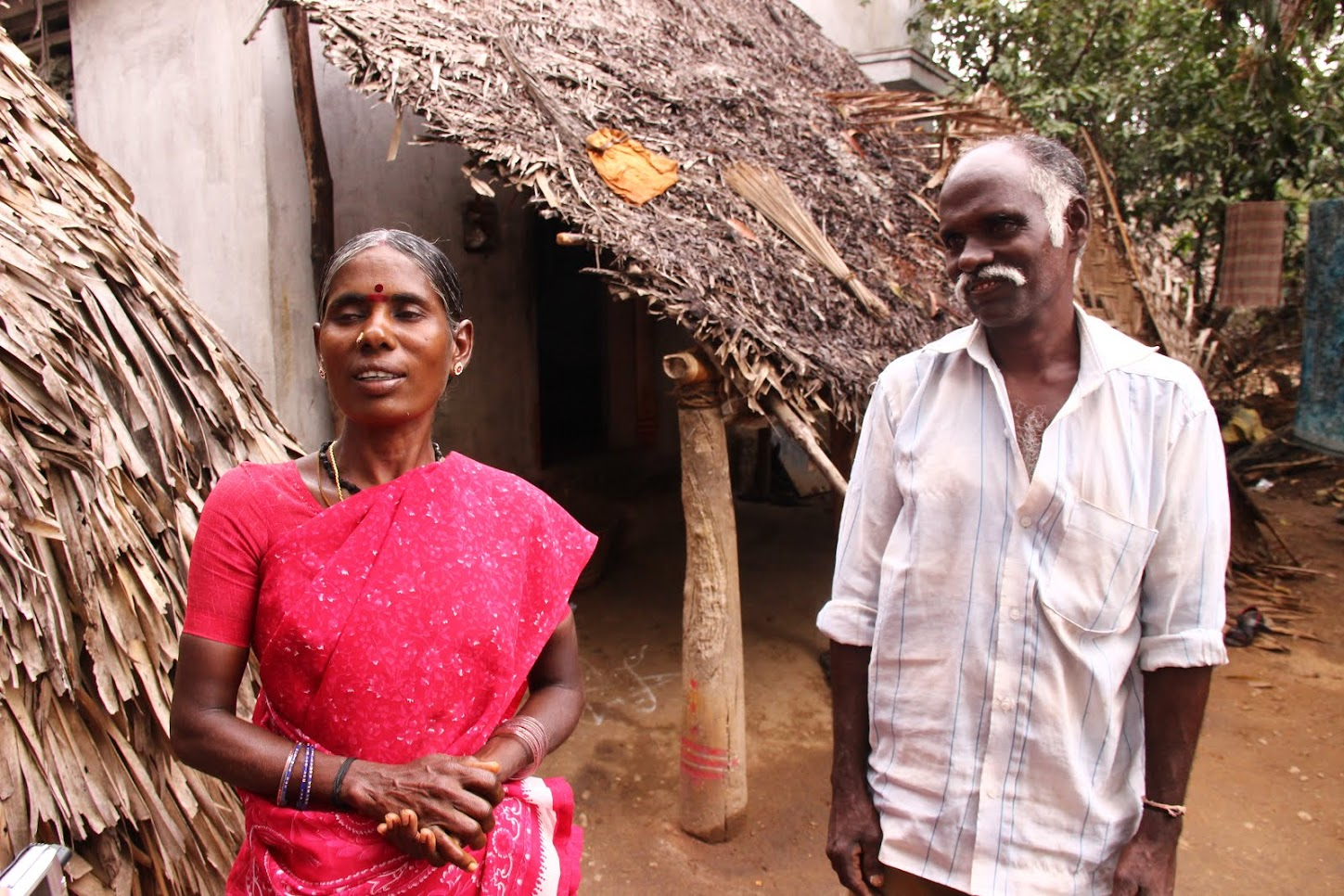 Pushpa (L) and Vadivelu, outside their house in Chenneri Village. Credit: Roy Benadict Naveen
