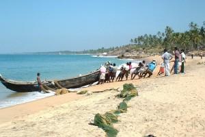 Fishermen on Kovalam beach, Kerala. Credit: Wikipedia