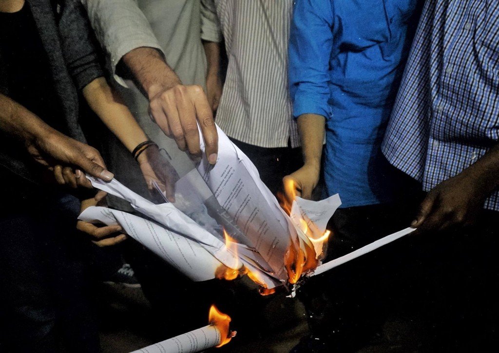 Copies of the ancient text Mansmriti being burnt by students at JNU