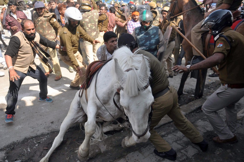 The police horse, Shaktiman, lies injured after BJP activists protesting the Uttarakhand government in Dehradun beat it with bamboo sticks. Credit: PTI