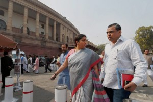 Union HRD Minister Smriti Irani with BJP MP and Bollywood actor Paresh Rawal  outside Parliament during the budget session in New Delhi on Tuesday. Credit: PTI Photo by Shahbaz Khan