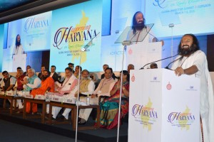 Founder of Art of Living Foundation Sri Sri Ravi Shankar addresses entrepreneurs at the 'Happening Haryana Global Investors Summit 2016' in Gurgaon on Tuesday. Credit: PTI