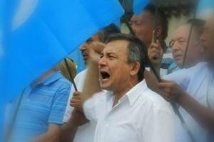 Dolkun Isa seen at an Uighur rights protest. Credit: Facebook