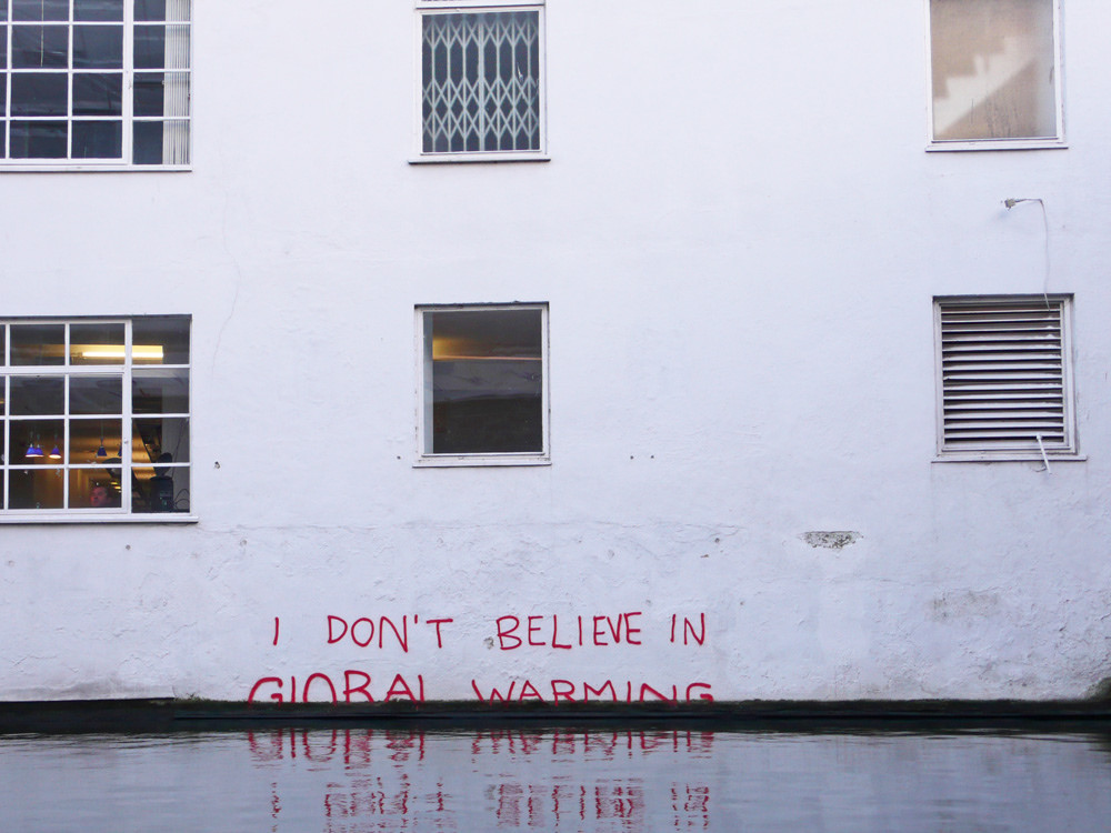"""I don't believe in global warming"" by Banksy. Credit: dullhunk/Flickr, CC BY 2.0"