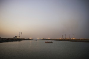 View of Tata power plant (on the left) and Adani power plant (on right) at sunset. October, 2014. Credit: Sami Siva / ICIJ