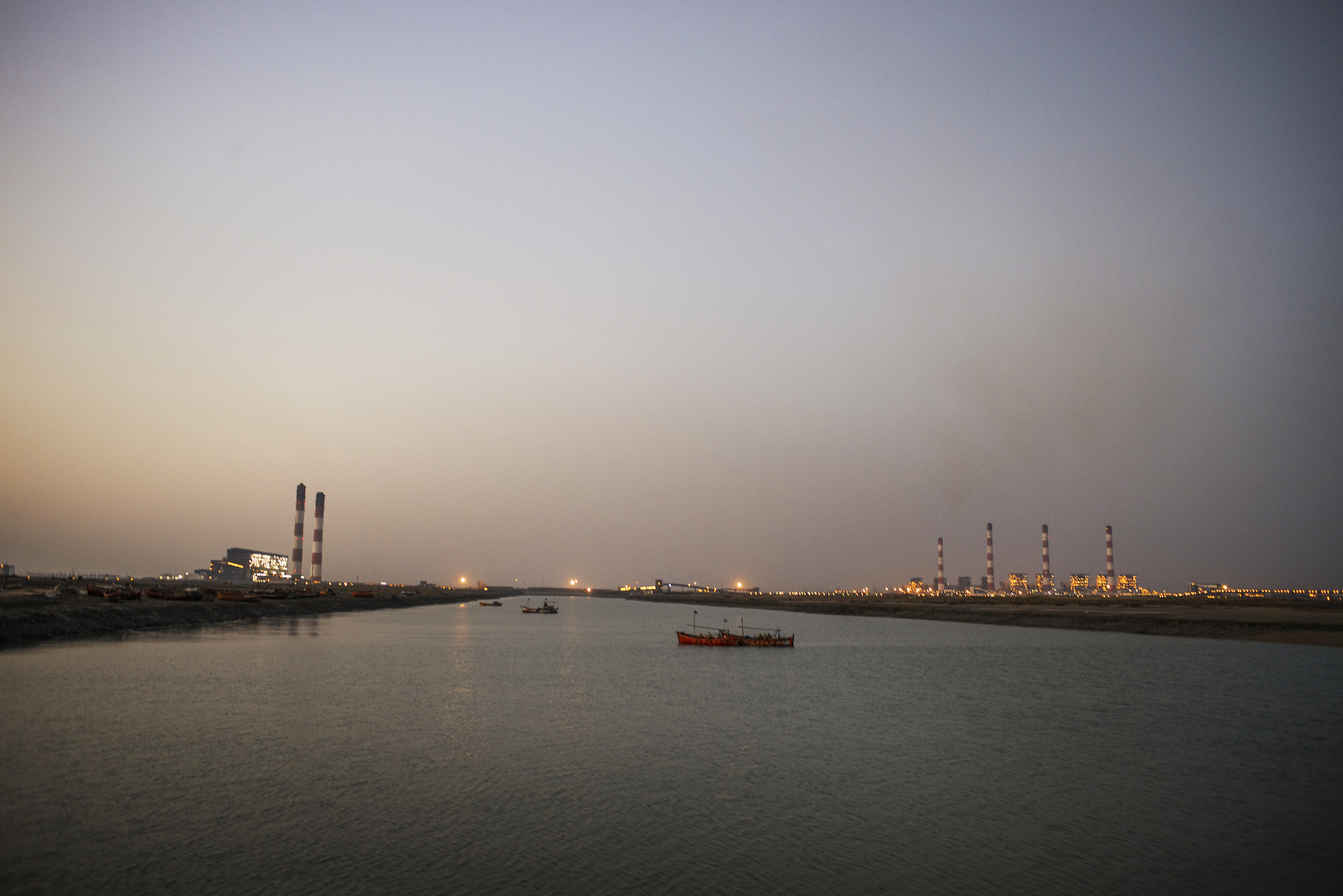 View of the Tata power plant (on the left) and the Adani power plant (on right) at Mundra, Gujarat. Credit: Sami Siva / ICIJ