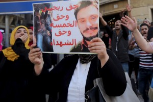 An Egyptian activist holds a poster calling for justice for the recently murdered Italian student Giulio Regeni during a demonstration protesting the government's decision to transfer two Red Sea islands to Saudi Arabia, in front of the Press Syndicate in Cairo, Egypt, April 15. Credit: Reuters/Mohamed Abd El Ghany