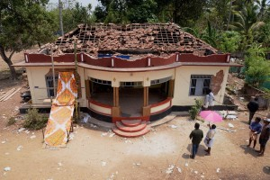 Paravoor : A view of a damaged building after a massive fire broke out during a fireworks display in Paravoor north of Thiruvananthapuram, in Kerala on Sunday. Dozens were killed and many more were injured when a spark from an unauthorised fireworks show ignited a separate batch of fireworks that were being stored at the temple complex. Credit: PTI