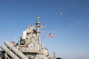 An US navy picture shows what appears to be a Russian Sukhoi SU-24 attack aircraft flying over the US guided missile destroyer USS Donald Cook in the Baltic Sea in this picture taken April 12, 2016 and released April 13, 2016. REUTERS/US Navy/Handout via Reuters