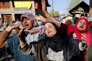 Relatives mourn after the death of civilians in firing by security forces in Handwara. Credit: PTI