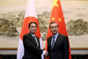 Japanese Foreign Minister Fumio Kishida (L) shakes hands with China's Foreign Minister Wang Yi during a meeting at Diaoyutai State Guesthouse, in Beijing, China. Credit: Reuters