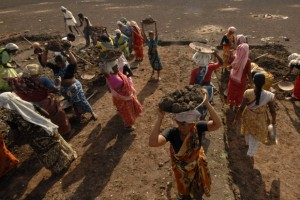 Labourers work on a dried lake to try and revive it under the Mahatma Gandhi National Rural Employment Guarantee Act (MGNREGA) on the outskirts of Hyderabad. Credit: Reuters/Files