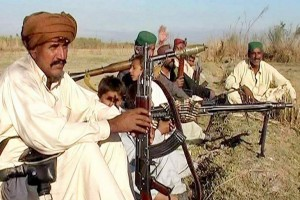 An undated picture shows Ghulam Rasool alias Chotoo (right), the head of Chotu gang and his aides holding heavy weapons. Credit: PakistanToday