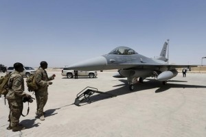 US Army soldiers look at a F-16 fighter jet during an official ceremony to receive four of these aircrafts from the US, at a military base in Balad, Iraq. Credit: Reuters