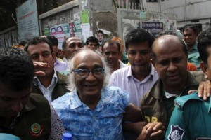 Bangladeshi security personnel escort Shafik Rehman (C) at a court following his arrest in Dhaka on April 16. Credit: AFP