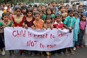 """File photo of children in a rally to mark """"World Day against Child Labour"""" in Kolkata. Credit: PTI Photo by Ashok Bhaumik"""