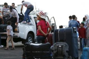 A Syrian girl waits near suitcases as other Syrians arrive at Lebanon's northern Tripoli port to embark a passenger ferry to Turkey September 22, 2015. Credit: Reuters/Jamal Saidi