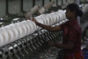 A worker tends to yarn-spinning equipment at a factory in Coimbatore, about 500 km (310 miles) from Chennai, January 8, 2013. Credit: Reuters/Babu/Files