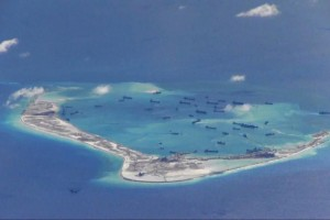 Chinese dredging vessels are purportedly seen in the waters around Mischief Reef in the disputed Spratly Islands in the South China Sea in this still image from video taken by a P-8A Poseidon surveillance aircraft provided by the United States Navy May 21, 2015. Credit: Reuters/U.S. Navy/Handout