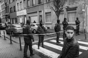 BELGIUM, Molenbeek Saint Jean (Brussels). 16/11/2015:  Inhabitants prevented from going home by masked policemen in the Ransfort street who prevent access to the security perimeter set up during an operation at house number 75 and around the Delaunoy street in the predominantly Muslim burrough of Molenbeek Saint Jean, in connection with the terrorists attacks in Paris of the previous Friday.