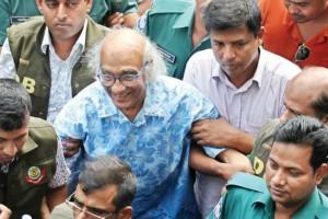 Senior journalist Shafik Rahman being led away by the police in Dhaka last week. Credit: Dhaka Tribune
