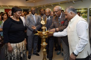 New Delhi: Mos for External Affairs V K Singh with Dean of Group of African Heads of Mission, Alem Tsehaye Woldemariam lights the lamp to inaugurate an exhibition as part of the Africa Day Celebration at ICCR in New Delhi on Thursday. PTI Photo by Manvender Vashist  (PTI5_26_2016_000231B) *** Local Caption ***
