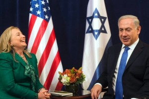 Then-US Secretary of State Hillary Clinton laughs as she meets with Israeli Prime Minister Benjamin Netanyahu, September 27, 2012. Credit: Reuters/Files