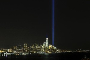 The Tribute in Light is illuminated next to the One World Trade Center during events marking the 14th anniversary of the 9/11 attacks on the World Trade Center in New York September 11, 2015. Credit: Reuters/Eduardo Munoz/Files